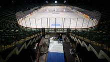 A rink attendant leaves after resurfacing the ice at the Abbotsford Entertainment and Sports Centre, current home of the Abbotsford Heat AHL hockey team, in Abbotsford, B.C., on Tuesday April 15, 2014. The city announced it is ending the contract with the Calgary Flames' farm team at the conclusion of this season. (DARRYL DYCK/THE GLOBE AND MAIL)