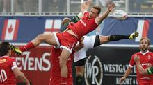 Canada's Harry Jones vies for the ball against South Africa during a 2016 USA Sevens Rugby Tournament match at the Sam Boyd Stadium in Las Vegas on March 4. (MARK RALSTON/AFP/Getty Images)