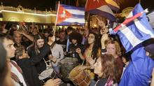 Cuban-Americans celebrate the death of Fidel Castro, Saturday, Nov. 26, 2016, in the Little Havana area in Miami. Castro died eight years after ill health forced him to formally hand power over to his younger brother Raul, who announced his death late Friday, Nov. 25, on state television. (Alan Diaz/AP Photo/)