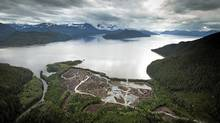 Workers clear the land at the Kitimat LNG site on Sept. 28, 2011, on the Douglas Channel, which leads out to the Pacific Ocean. Natural gas will be delivered via a pipeline on loaded on to ship head for Asia. (John Lehmann/The Globe and Mail/John Lehmann/The Globe and Mail)