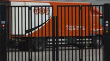 A TNT delivery truck is seen behind a closed gate in Hoofddorp, near Amsterdam, Netherlands, Feb. 21, 2012. TNT Express NV sidestepped questions Monday about an unsolicited UPS takeover bid, announcing instead an abrupt switch in strategy to focus on its European operations after posting a large fourth-quarter loss partly due to problems at its Brazilian arm. (Peter Dejong/AP)
