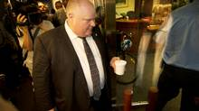 Mayor Rob Ford runs the media gauntlet to get back to his office at City Hall in Toronto on May 31, 2013. (Peter Power/The Globe and Mail)