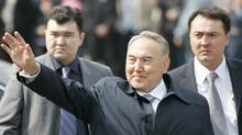 Kazakhstan's President Nursultan Nazarbayev (C), accompanied by security officers, waves during Navruz celebrations in Almaty March 22, 2007. Navruz, an ancient holiday marking the spring equinox, is widely celebrated across Central Asia. (SHAMIL ZHUMATOV/REUTERS)