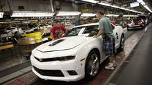 Workers at the General Motors Oshawa assembly plant work on the Chevrolet Camaro model on Aug. 28, 2013. The last Canadian-built version of the car will roll off the assembly line on Nov. 20. (Moe Doiron/The Globe and Mail)