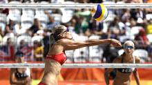 Canada's Sarah Pavan passes a ball during a women's beach volleyball round of 16 match against her compatriots Jamie Broder and Kristina Valjas at the 2016 Summer Olympics in Rio de Janeiro, Brazil, Saturday, Aug. 13, 2016. Canada won the match. Canada Lost. (Petr David Josek/AP)