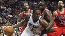 Philadelphia 76ers forward Elton Brand drives to the basket around Chicago Bulls' Carlos Boozer, rear left, Luol Deng, center, and Taj Gibson (22) during Game 4 in a first-round NBA basketball playoff series in Philadelphia, Sunday, May 6, 2012. (Associated Press)
