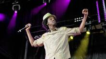 K'naan impressed with his Wavin' Flag. (Jennifer Roberts for The Globe and Mail)