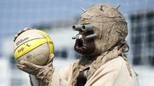 A member of the 501st Legion, a group of Star Wars enthusiasts, plays beach volleyball at Polson Pier in Toronto on Aug. 21, 2013. (Kevin Van Paassen/The Globe and Mail)