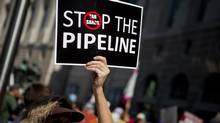 A woman protests the Keystone XL pipeline in Washington, D.C., in a file photo. (Andrew Harrer/Bloomberg)