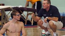 Swin coach Cecil Russell speaks to his son Colin poolside at the Commomwealth Games trials in Victoria, BC on November 24, 2005. (Diana Nethercott/The Globe and Mail)