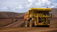 Remotely controlled tipper trucks operate at a Rio Tinto iron ore mine in Western Australia. (Handout)