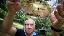 Paul Hebert, scientific director of International Barcode of Life, shows off his backyard insect trap on Saturday. (Glenn Lowson for the Globe and Mail)