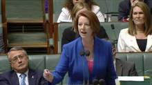 Australian Prime Minister Julia Gillard laces into opposition leader Tony Abbott on Tuesday during an address to the House of Representatives in Canberra.