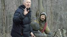 Director John Hillcoat, left, on the set of The Road with star Viggo Mortensen: Unlike most post-apocalyptic stories, says Hillcoat, 'this is not science fiction.'