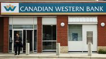 A customer walks out of a Canadian Western Bank branch in Calgary, Alberta June 9, 2009. (Todd Korol/Reuters/Todd Korol/Reuters)