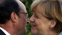 French President Francois Hollande (L) welcomes German Chancellor Angela Merkel before talks and a dinner at the Elysee Palace in Paris, France, July 6, 2015. REUTERS/Philippe Wojazer (PHILIPPE WOJAZER/Reuters)