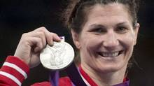 Canada's Tonya Verbeek holds up her silver medal for 55kg freestyle wrestling at the 2012 Summer Olympics on August 9 in London (Ryan Remiorz/The Canadian Press)