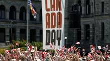People celebrate Canada Day on the lawn of the B.C. Legislature on July 1, 2013. (Chad Hipolito for The Globe and Mail)