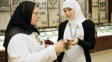 "Margaret and Sarah Kassem (l-r) look through jewellery at a department store after buying Sarah's prom dress inside Erin Mills Shopping Centre for the ""Sisters Prom"". (Charla Jones/Charla Jones/ Globe and Mail)"