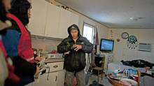 A man in Attawapiskat tries on gloves delivered by the Canadian Red Cross. (Johan Hallberg-Campbell/Red Cross/Johan Hallberg-Campbell/Red Cross)