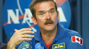 Astronaut Chris Hadfield gestures during a Canadian Space Agency news conference Saturday, Aug. 26, 2006 at the Kennedy Space Center.
