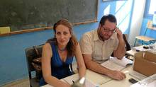 Ourania Papageorgiou, 34, left, who works as a civil lawyer, and Yannis Delimichaslis, a 35-year-old accountant, at a Greek polling station on Sunday. (Eric Reguly/The Globe and Mail)