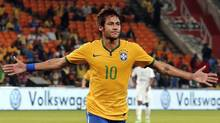 Brazil's Neymar celebrates his goal against South Africa during their international friendly soccer match at the First National Bank (FNB) Stadium, also known as Soccer City, in Johannesburg, in this March 5 2014 file photo. (SIPHIWE SIBEKO/REUTERS)