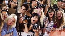 """Fans react to actor Darren Criss (not seen) arriving on the red carpet for the gala presentation of the film """"Imogene"""" at the 37th Toronto International Film Festival, September 7, 2012. (MARK BLINCH/REUTERS)"""