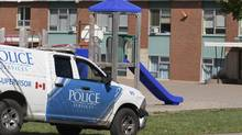 A Charlottetown Police vehicle drives into Sherwood Elementary School on Sept. 21, 2016. (JOHN MORRIS/REUTERS)