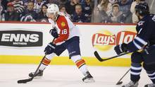 Florida Panthers right wing Reilly Smith (18) controls the puck during the third period against the Winnipeg Jets at MTS Centre. Florida Panthers win 3-2. (Bruce Fedyck/USA Today Sports)