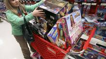 A Black Friday shopper loads up her cart in a Target store in Chicago. (JOHN GRESS/REUTERS)