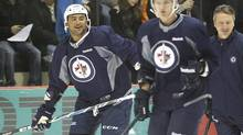 Winnipeg Jets Dustin Byfuglien (33) hits the ice at the 2011 training camp in Winnipeg. The Winnipeg Jets had their first practice in Winnipeg Saturday, September 17, 2011. (John Woods/THE CANADIAN PRESS)