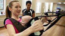 Ali de Bold, co-founder of ChickAdvisor.com, works out with her son Jake de Bold, 3 months and Fit Mom Instructor Debbie King, an instructor with Think Fitness in Toronto, Ontario, Canada. (Deborah Baic / The Globe and Mail/Deborah Baic / The Globe and Mail)