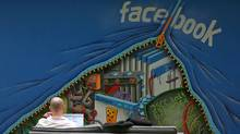 An employee works on a computer at the new headquarters of Facebook in Menlo Park, California in this January 11, 2012 file photo. The attacks against Facebook signal that social media has become a new front in the Silicon Valley patent wars. Before 2010, online game developer Zynga, Web discount deals operator Groupon and professional social network operator LinkedIn had not faced a single patent lawsuit. Last year, the year those three companies went public, the lawsuits mounted. (ROBERT GALBRAITH/Robert Galbraith/REUTERS)