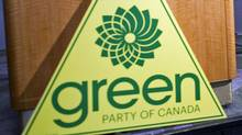 A Green Party sign sits at the foot of a podium in Vancouver on March 30, 2011, before leader Elizabeth May discusses her exclusion from the televised election debates. (ANDY CLARK/REUTERS)
