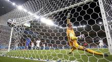 England's goalkeeper Joe Hart fails to stop a goal by Italy's Mario Balotelli's during the second half of the group D World Cup soccer match between England and Italy at the Arena da Amazonia in Manaus, Brazil, Saturday, June 14, 2014. The goal gave Italy a 2-1 win. (Marcio Jose Sanchez/AP)