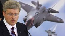 Prime Minister Stephen Harper speaks to employees at Virtek Vision International Inc., which deals with lasers and manufacturing the materials used in the new F-35 fighter jet, in Waterloo, Ont., on March 11, 2011. (Fred Thornhill/Reuters/Fred Thornhill/Reuters)