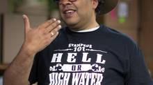 Calgary Mayor Naheed Nenshi with his Hell or High Water Calgary Stampede T-shirt and Smithbuilt Hat in Calgary, Alberta, July 3, 2013. (Todd Korol For The Globe and Mail)