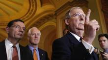 Republican Senator Mitch McConnell of Kentucky, foreground, could face trouble in his bid for re-election next year. His support for a bipartisan accord on the budget is sparking an insurgent challenge for the nomination from the far-right Tea Party. (YURI GRIPAS/REUTERS)