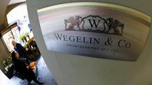 A logo of the Swiss bank Wegelin is pictured at a building in Bern, in this Jan. 27, 2012 file photo. (MICHAEL BUHOLZER/REUTERS)