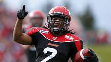 Calgary Stampeders Larry Taylor celebrates his game winning touchdown during the second half of their CFL football game against the Edmonton Eskimos in Calgary, Alberta, September 3, 2012. (TODD KOROL/REUTERS)