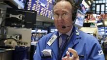 Trader Steven Kaplan works on the floor of the New York Stock Exchange Wednesday, March 12, 2014. (Richard Drew/AP)