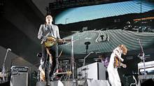 Canadian band Arcade Fire performs on stage, August 29, 2010, during the Rock en Seine festival at the Saint-Cloud park, a Paris western suburb. (AFP/AFP/Getty Images)