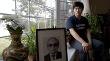 Soojeong Choe, 17, who started an Alzheimer's disease club at his school shortly after his grandfather passed away, poses for a portrait with a photo of his grandfather. (Michelle Siu for The Globe and Mail/Michelle Siu for The Globe and Mail)