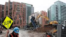 An excavator digs at a condominium construction site on what used to be a neighborhood of single family homes in Toronto, Ontario. (CHRIS HELGREN/REUTERS)