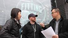 Rotman MBAs Sookie Ma, left, and Budianto Tandjono, right, have been working with local Toronto entrepreneurs, including Bryan Brock, centre, of the Fitting Room barbershop, to inject some ideas into their neighbourhoods. (Jennifer Lewington/The Globe and Mail)