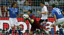Italy's Gianluigi Buffon (2nd L) makes a save next to Germany's Mario Gomez during their Euro 2012 semi-final soccer match at the National stadium in Warsaw, June 28, 2012. (THOMAS BOHLEN/REUTERS)