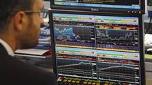 A stock trader looks on the graph displaying activity on the French Stock Exchange, in Paris, Tuesday, Aug. 16, 2011. (Francois Mori/AP/Francois Mori/AP)
