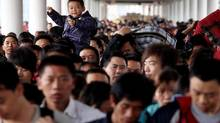 Passengers rush to board a train at the Guangzhou railway station, Guangdong province, China. (JOE TAN/JOE TAN/REUTERS)