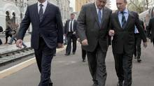 Mr. Yakunin, centre, is seen conferring with Russian President Vladimir Putin in this 2012 photo. (Alexei Druzhinin/AP)
